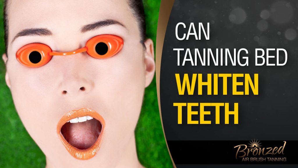 woman showing white teeth in tanning bed